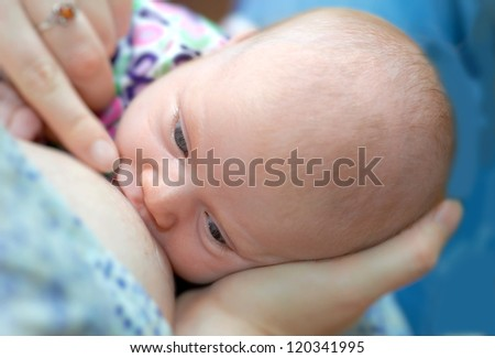 A photo of a Mother breast feeding newborn baby - stock photo