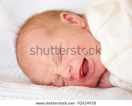 A photo of a Newborn baby crying - stock photo