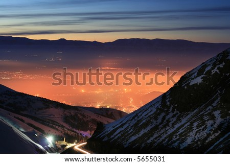 A photo of a night city lanscape from mountain - stock photo
