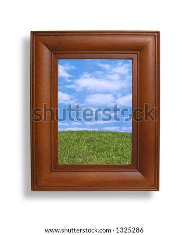 A photo of a picture frame with a nature setting inside - stock photo