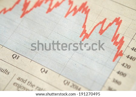 A photo of a printed Financial Data Graph showing performance of stocks and shares. - stock photo