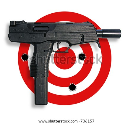 A photo of a real gun on top of target with bullet holes - stock photo