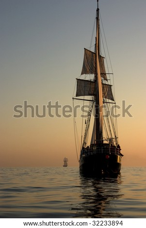 A photo of a sailboat during a sunrise