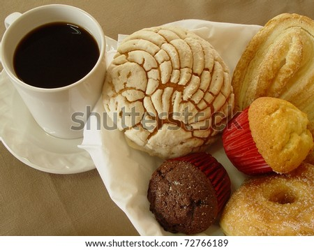 A Photo of a scene with a cup of coffee and bakery - stock photo
