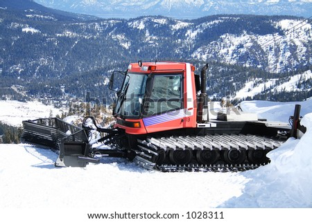 A photo of a snowplow on top of a mountain - stock photo