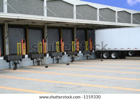 A photo of a truck backed into a loading zone - stock photo