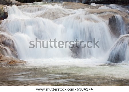 a photo of a water torrent in the forest