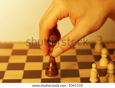 A photo of a woman playing chess - stock photo