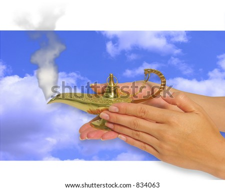 A photo of a woman rubbing a genie lamp - stock photo