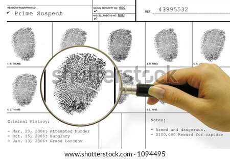 A photo of a woman with a magnifying glass inspecting a fingerprint card - stock photo