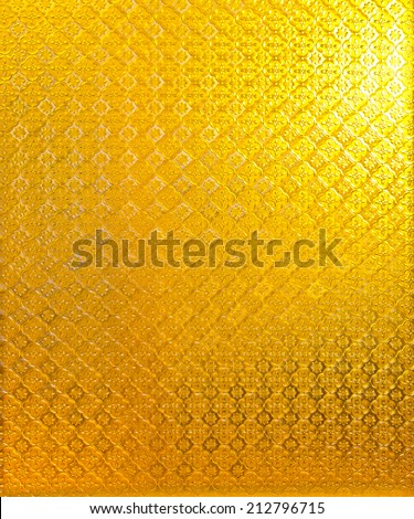 a photo of abstract background yellow glass - stock photo