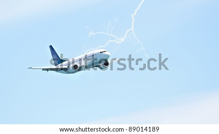 A  photo of an airplane and lightening - stock photo