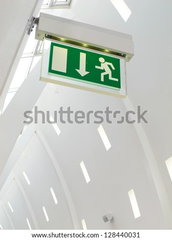 A photo of an exist sign in modern white building - stock photo