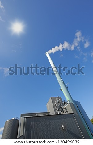 A photo of an industrial chimney - stock photo