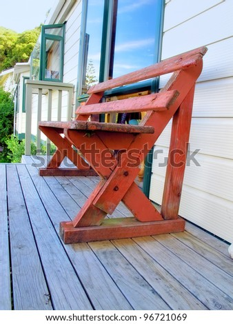 A photo of an outdoor private bench - stock photo