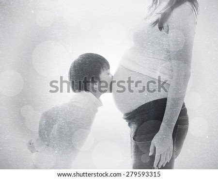 a photo of asian boy kiss belly pregnant asian woman ,vintage style with fabric texture and bokeh - stock photo