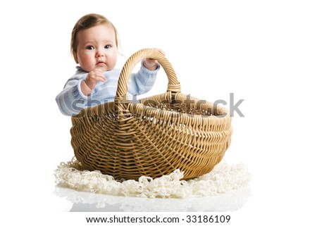 A photo of baby in the basket, isolated - stock photo