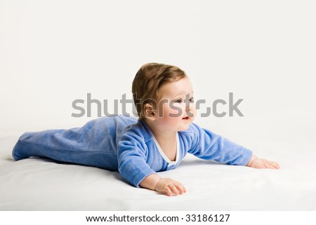 A photo of baby, lying down, isolated