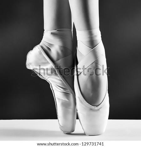 A photo of ballerina's pointes on black background - stock photo