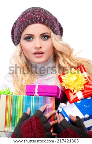 A photo of beautiful girl is in winter clothes with red gift box,  isolated