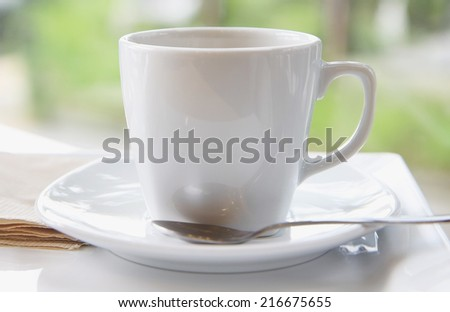 a photo of black coffee in white mug on table - stock photo