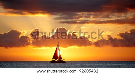 A photo of Boat, ocean and sunset - Oahu, Hawaii - stock photo