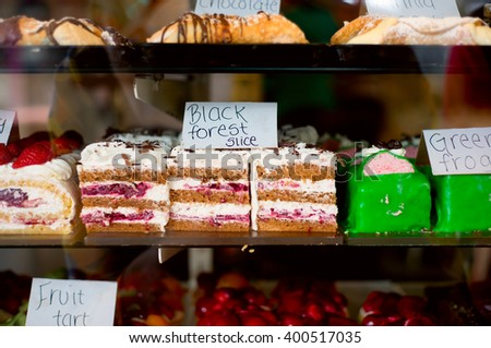 A photo of cakes from famous cake and patisserie shops located on Acland street, Melbourne, Australia. Photo was taken through the window.