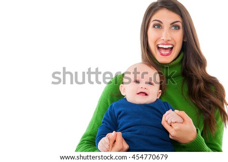 A photo of cheerful woman with baby boy. Happy mother and son are wearing casuals. They are spending leisure time isolated over white background. - stock photo