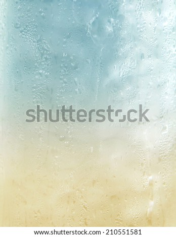 a photo of close up cool water with ice in glass - stock photo