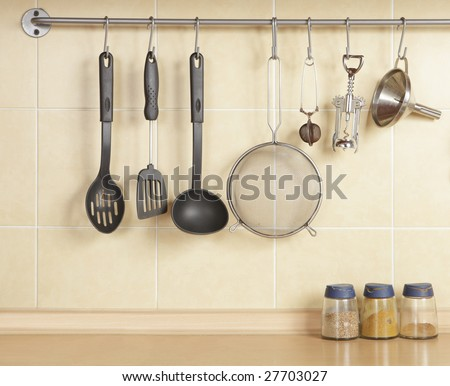 a photo of cookware set over yellow wall - stock photo