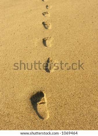 A photo of footprints in the sand - stock photo