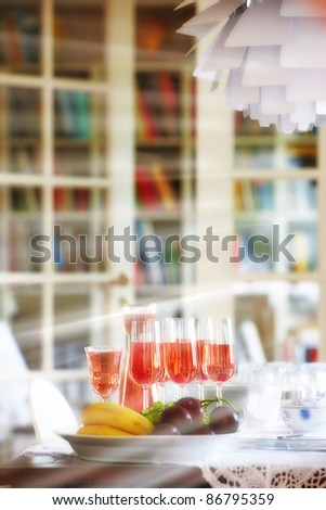 A photo of glasses of wine in the dinning room - stock photo