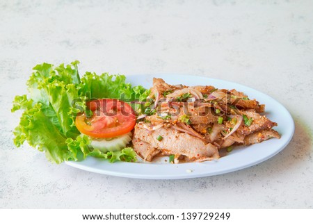 a photo of grilled neck pork with spicy herb,thai tradition food