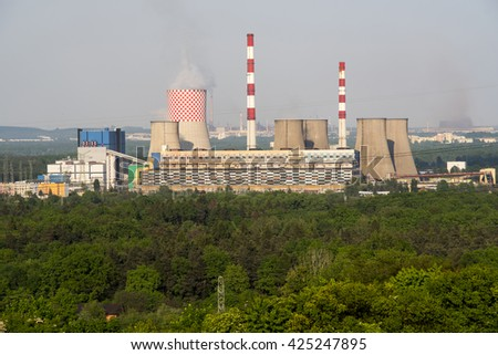a photo of industrial buildings from factory chimneys - stock photo