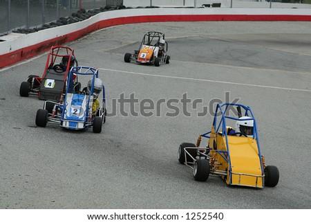 A Photo Of Kids Racing Go Karts