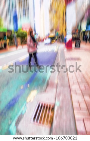 A photo of motion blurred city life - stock photo