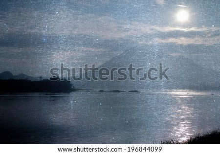 a photo of mountain and river with sunlight - stock photo