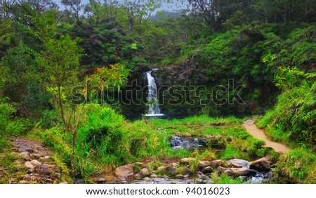 A photo  of rainforest and waterfall and river - stock photo