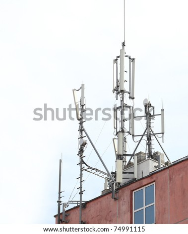 A photo of roof with network broadcasting antennas - stock photo