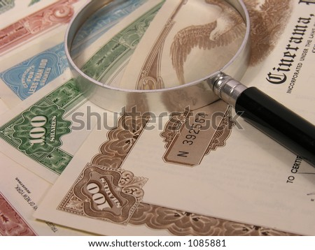 A photo of several different stock certificates - stock photo