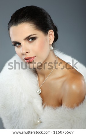 A photo of sexual beautiful girl is in fur clothes