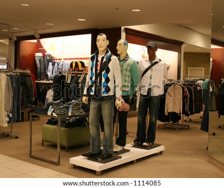 A photo of stylish mannequins in a department store - stock photo