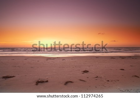 a photo of sunset and beach