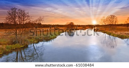 A photo of sunset and small river - stock photo