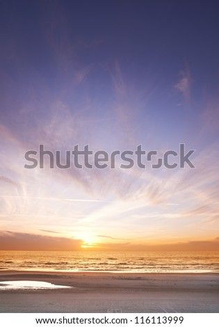A photo of sunset  - beach and ocean - stock photo