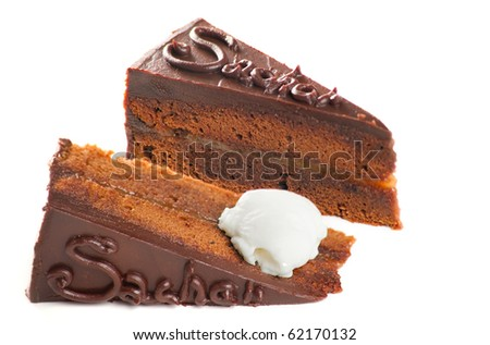A photo of the Austrian Sacher Torte cake, filled with apricot preserve and frosted with dark chocolate with a dollop of whipped cream. Isolated on white