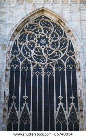 A photo of the beautiful window of Milan's Duomo Cathedral. - stock photo