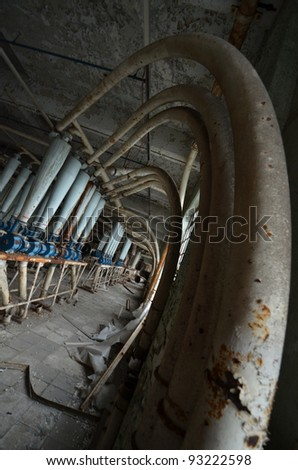 A photo of the internal workings of a grain mill - stock photo