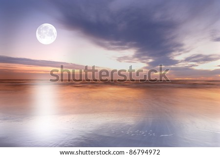 a photo of the moon at the beach - stock photo