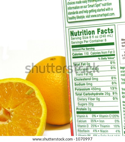 A photo of the nutritional information of a carton and oranges - stock photo